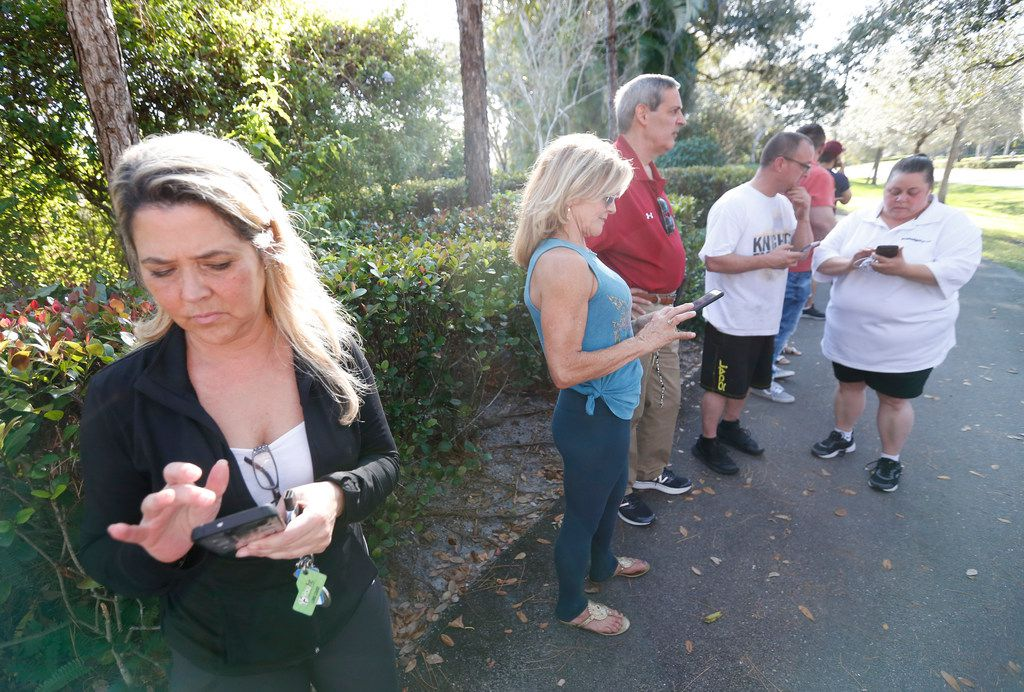 Anxious family members wait for information on students, Wednesday, Feb. 14, 2018, in Parkland, Fla. A shooting at Marjory Stoneman Douglas High School sent students rushing into the streets as SWAT team members swarmed in and locked down the building. Police were warning that the shooter was still at large even as ambulances converged on the scene and emergency workers appeared to be treating those possibly wounded. (AP Photo/Wilfredo Lee)