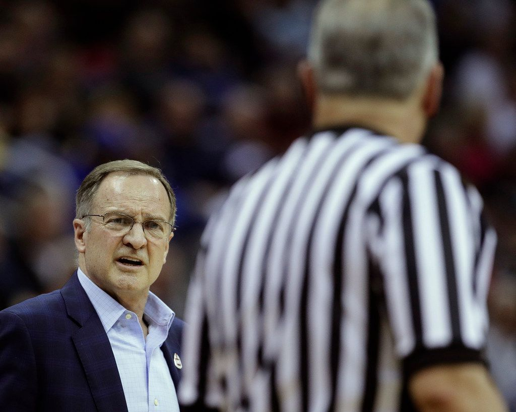 Oklahoma coach Lon Kruger talks to an official during the first half of the team's NCAA college basketball game against Oklahoma in the Big 12 men's tournament Wednesday, March 13, 2019, in Kansas City, Mo. (AP Photo/Charlie Riedel)
