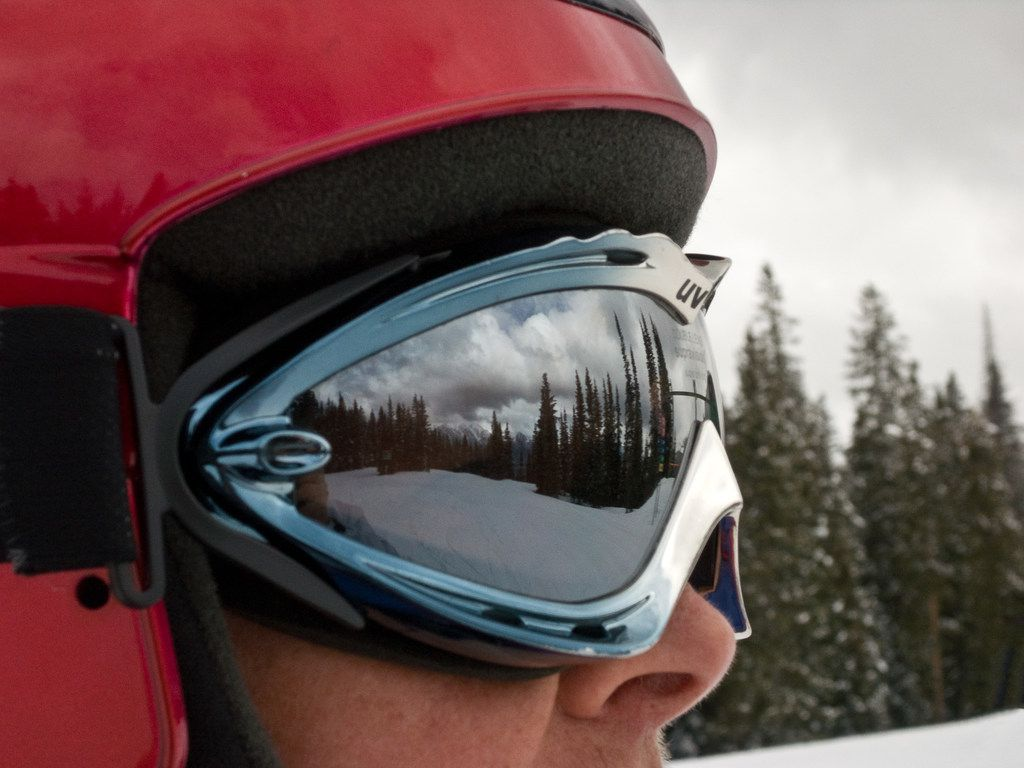 The lofty peaks of the San Juan Mountains reflect from a skier's goggles at the Purgatory Resort north of Durango, Colo.  Mountain scenery is one more reason to head for the hills in the winter. (Dan Leeth/Special Contributor)