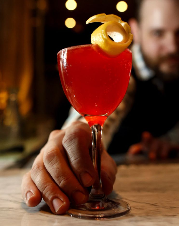 Máté Hartai the beverage director (Accent on a and e of first name) with The Whippet made with bianco vermouth, Texas grapefruit syrup (house made), and Aperol at Remedy in Dallas, on Saturday, January 3, 2015.
