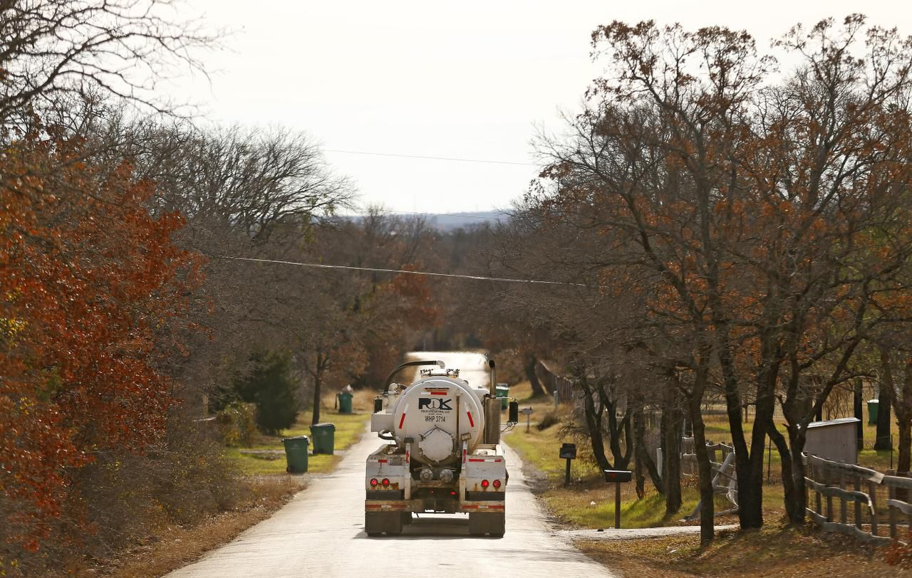 A truck hauling wastewater from gas drilling operations drives through a rural Parker County neighborhood in December 2014. SMU researchers say two deep underground wells used to dispose of fracking fluids likely caused a series of earthquakes starting in November 2013 in Parker County.