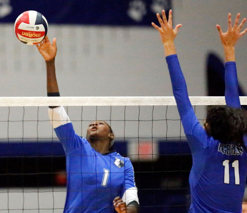 Plano West outside hitter Iman Ndiaye (1) makes a hit as Hebron right side K.C. Ortega (11) defends during game one as Plano West High School hosted Hebron High School in Plano on Tuesday, August 7, 2018. (Stewart F. House/Special Contributor)