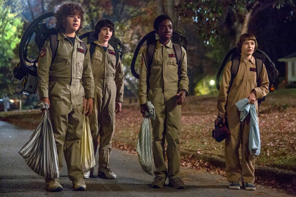 """This image released by Netflix shows Gaten Matarazzo, from left, Finn Wolfhard, Caleb McLaughlin and Noah Schnapp in a scene from the second season of """"Stranger Things."""" (Netflix via AP)"""