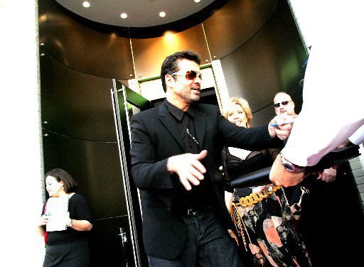 George Michael in 2005 outside of Goss Gallery on Cedar Springs in Dallas (Courtney Perry/Special Contributor)