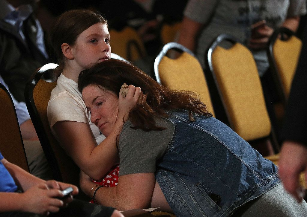 Supporters embrace as they await Hillary Clinton at the New Yorker Hotel on Wednesday.