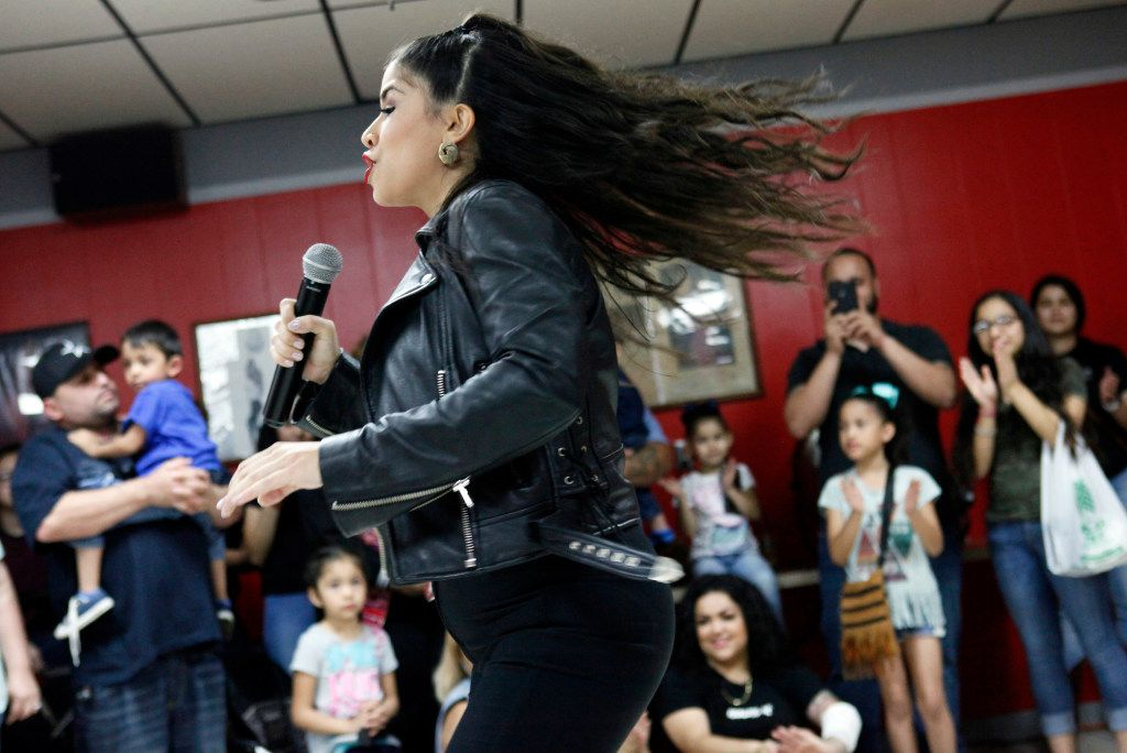 Cynthia Camero, 28, of Grand Prairie, performs during a talent contest at #214Selena: A Tribute to Selena at Country Burger restaurant in Dallas, Saturday, March 25, 2017. The fourth annual event hosted a Selena talent contest, lowriders, a Selena art show and a mural painting of the Queen of Tejano music by artists Arturo Donjuan and Ponchaveli Studios. Ben Torres/Special Contributor