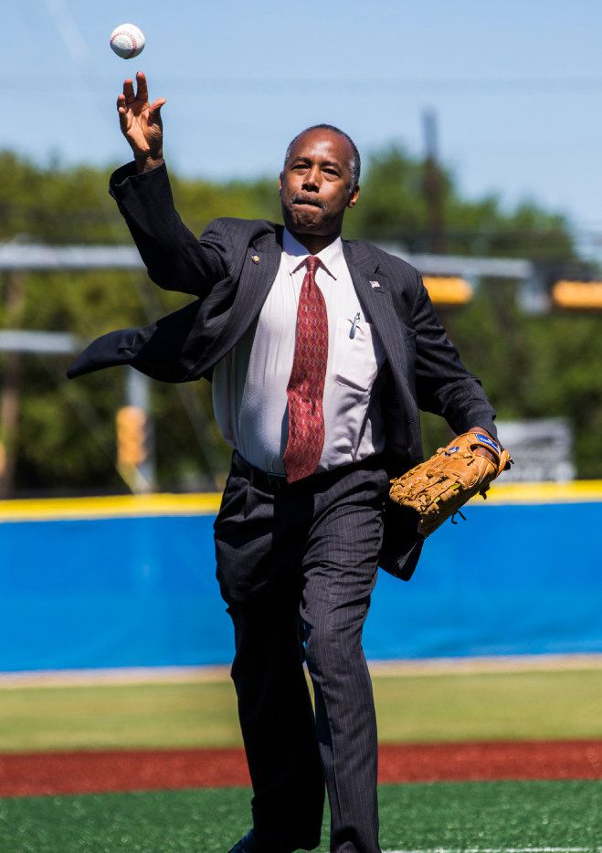 U.S. Secretary of Housing and Urban Development Ben Carson throws the opening pitch before a youth baseball game that took place during his tour of the Dallas Housing Authority's Major League Baseball Youth Academy in west Dallas. Carson is spending two days in Dallas-Fort Worth as part of a listening tour  of several U.S. cities. (Ashley Landis/Staff Photographer)