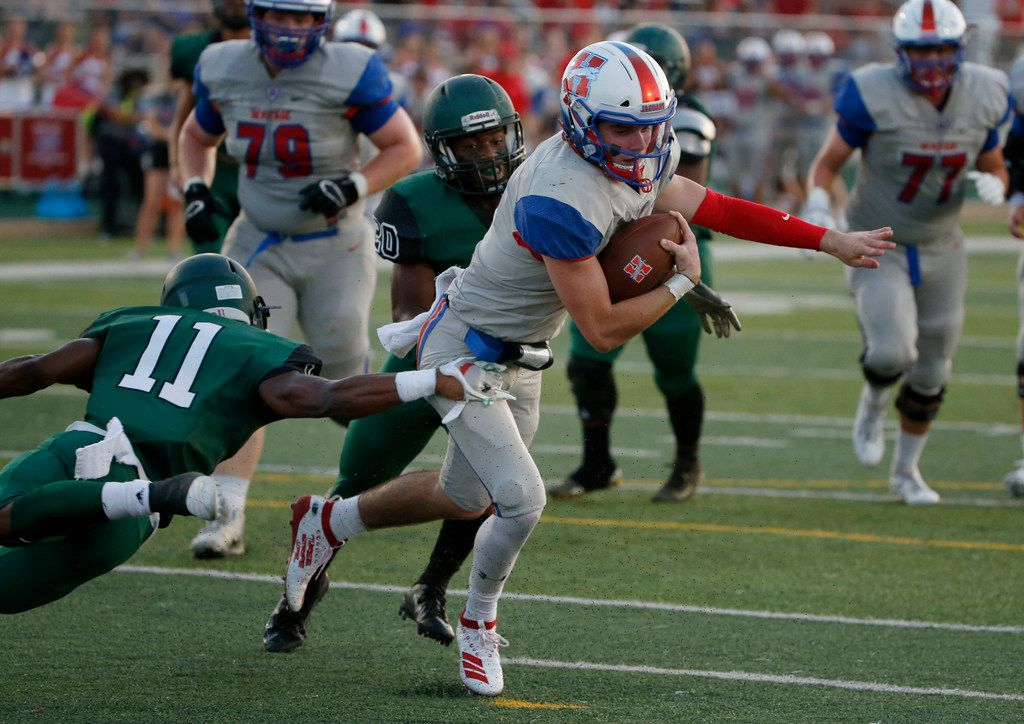 Midlothian Heritage quarterback Cade Sumbler (6) is tackled by Kennedale's Keirahyin Brown (11) and Micah Conner (20) after a short gain, during the first half of their high school football game in Kennedale, Texas on September 6, 2019.
