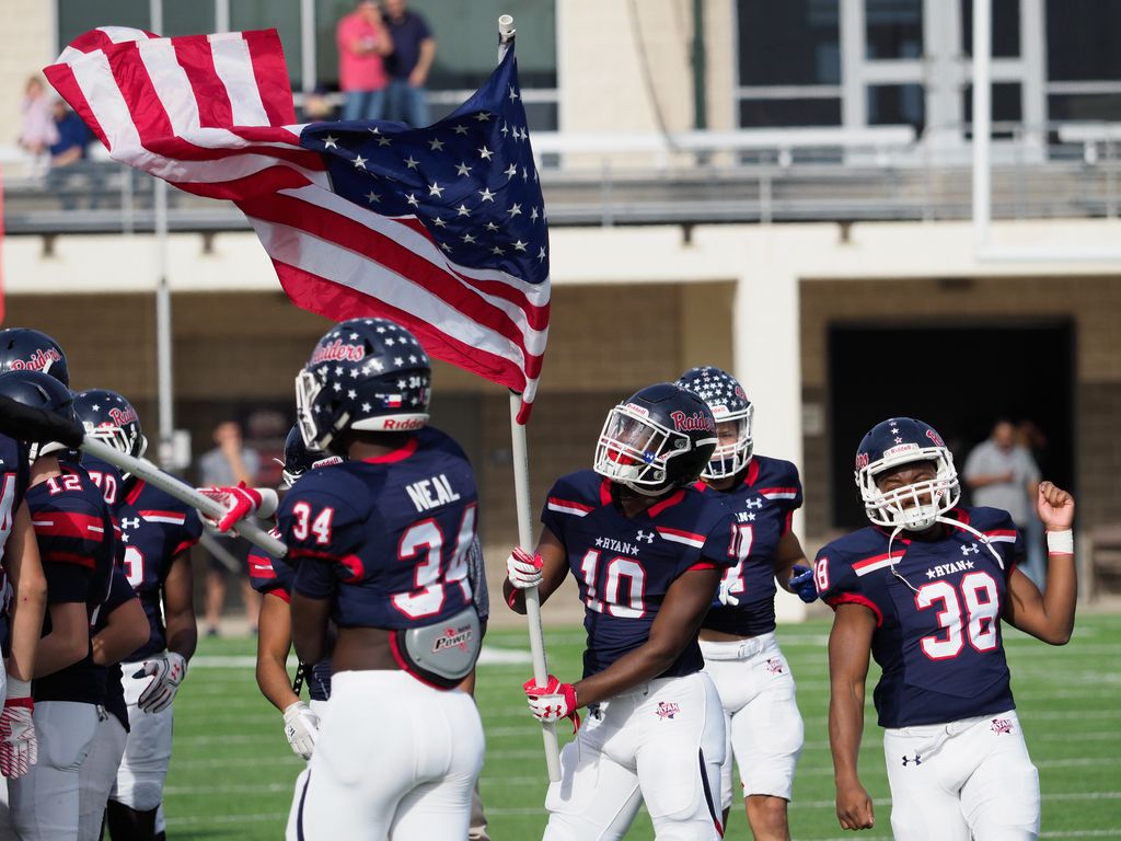 The Ryan High School football takes the field before they play their opponent, Monterey at C.H. Collins Athletic Complex, Saturday, December 2, 2017, in Denton, Texas, Jeff Woo/DRC