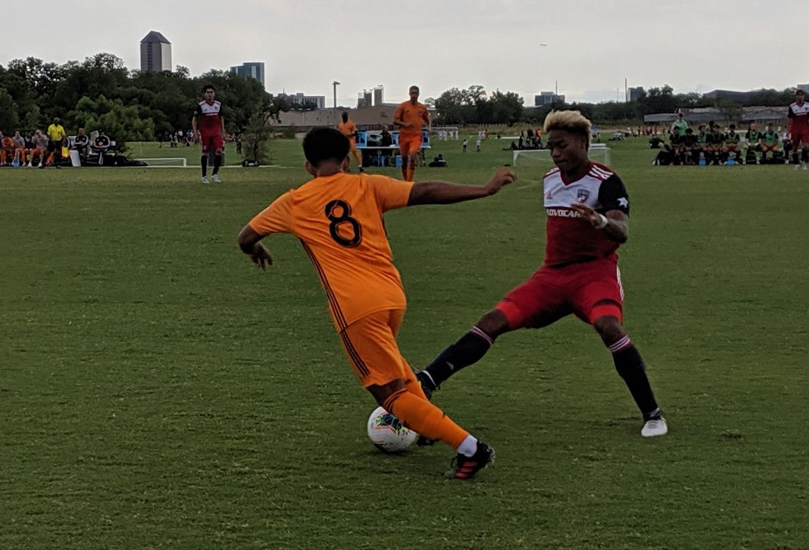 Malik Henry-Scott of FC Dallas attempts to steal the ball off of Edrey Caceres of the Houston Dynamo. (9-1-19)
