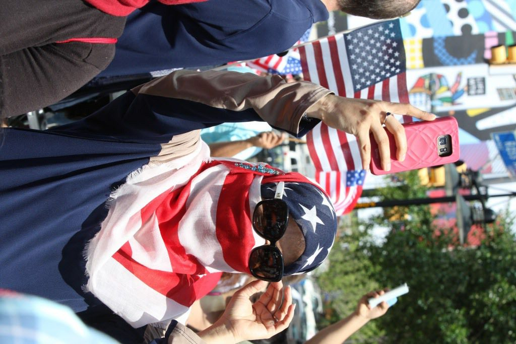 Fouzia Al-Amoodi, of Irving, Texas, takes a picture during the Dallas Mega March on Sunday, April 9, 2017 on Ross Ave in downtown Dallas.