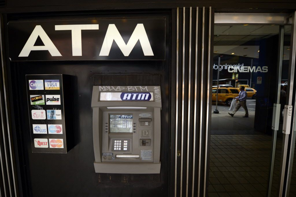 An ATM machine on Third Avenue in New York on May 10, 2013. Federal and local police in North Texas say they have broken up a crime ring that robbed ATM service technicians across Texas and in other states