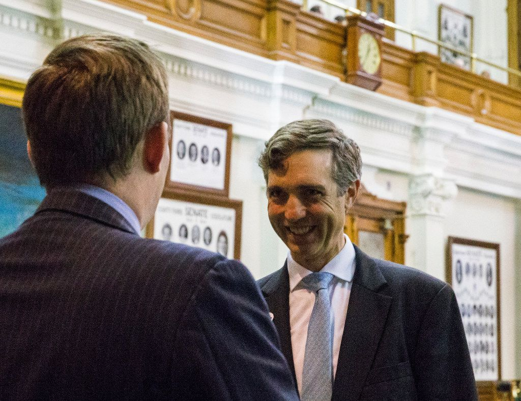 Senator Van Taylor, right, author of the Sunset Bill, is congratulated by Governor Greg Abbott's Chief of Staff Daniel Hodge, left, after the bill was passed during a midnight session of a special legislative session on Thursday, July 20, 2017 at the Texas state capitol in Austin.