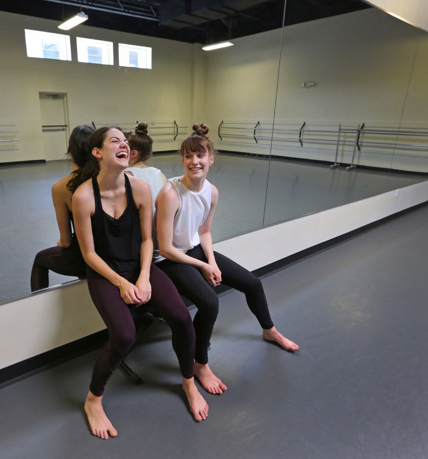 Emily Bernet and Taylor Rodman share a laugh during an interview at Preston Center Dance, where they are creating new work for their Bombshell Dance Project.