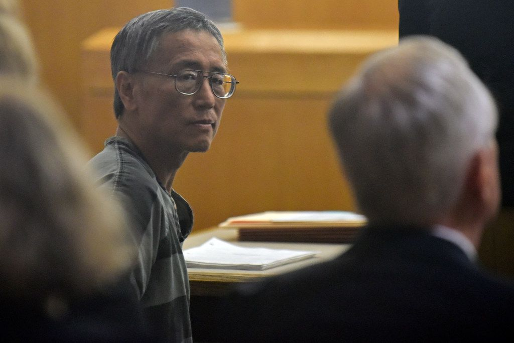 George Guo, far-left, glances behind him as his attorney Brad Lollar, far-right, points towards a person sitting in the 194th District Court for a Guo's hearing at the Frank Crowley Courts Building in Dallas, Friday morning Aug. 02, 2019. Guo will stand trail for the death of a woman who died from injuries she suffered 30 years after being attacked and raped by Guo in Highland Park.