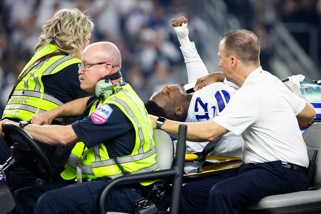 Dallas Cowboys wide receiver Allen Hurns (17) leaves the field on a stretcher after being injured on a play during the first half of an NFL wild-card playoff football game against the Seattle Seahawks at AT&T Stadium on Saturday, Jan. 5, 2019, in Arlington. (Smiley N. Pool/The Dallas Morning News)