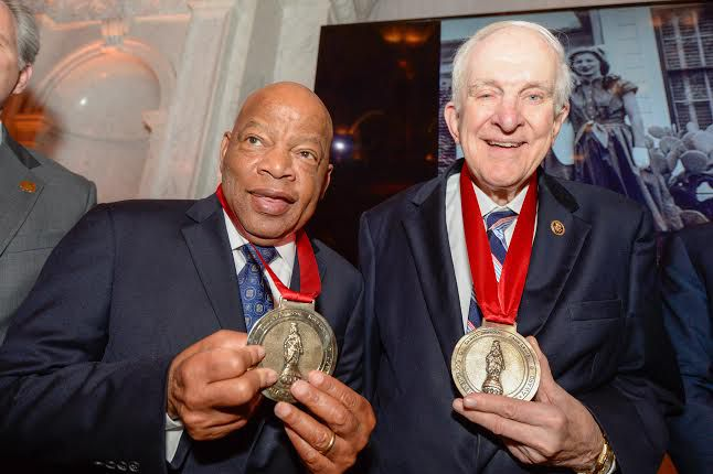 U.S. Reps. John Lewis and Sam Johnson displayed their awards from the Bipartisan Policy Center in March.