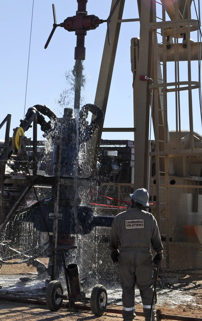 Water gushes out of a drilling pipe as it is pulled up to be replaced with a fresh pipe at a hydraulic fracturing site in Midland in 2013. The drilling method known as fracking uses huge amounts of high-pressure, chemical-laced water to free oil and natural gas trapped deep in underground rocks.