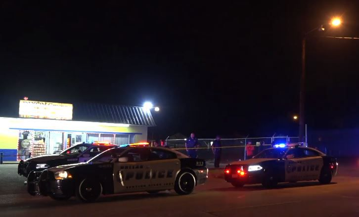 Dallas police squad cars gather outside a convenience store where a 20-year-old man was shot to death Wednesday night in South Dallas.