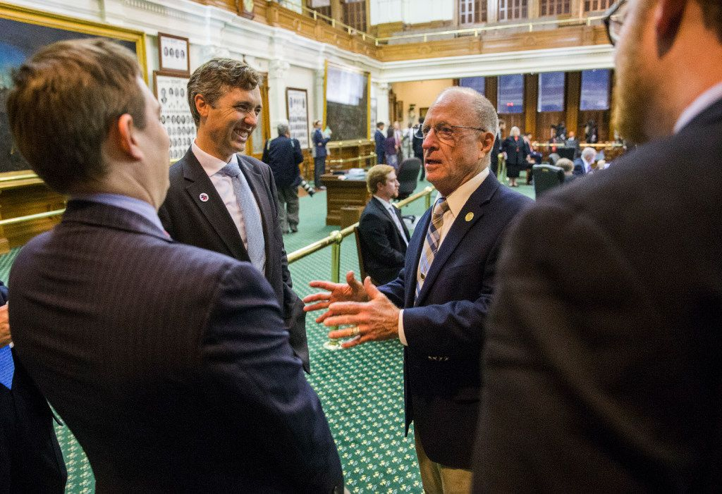 Sen. Van Taylor (center), author of the sunset bill, is congratulated by Sen. Bob Hall (second from right),  Gov. Greg Abbott's Chief of Staff Daniel Hodge (left)  and others after the bill was passed during a midnight session of a special legislative session on Thursday at the Texas Capitol in Austin.