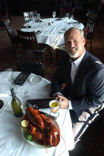 2005 file photo: Steve Fields shows off a 4-pound lobster at his Plano restaurant.
