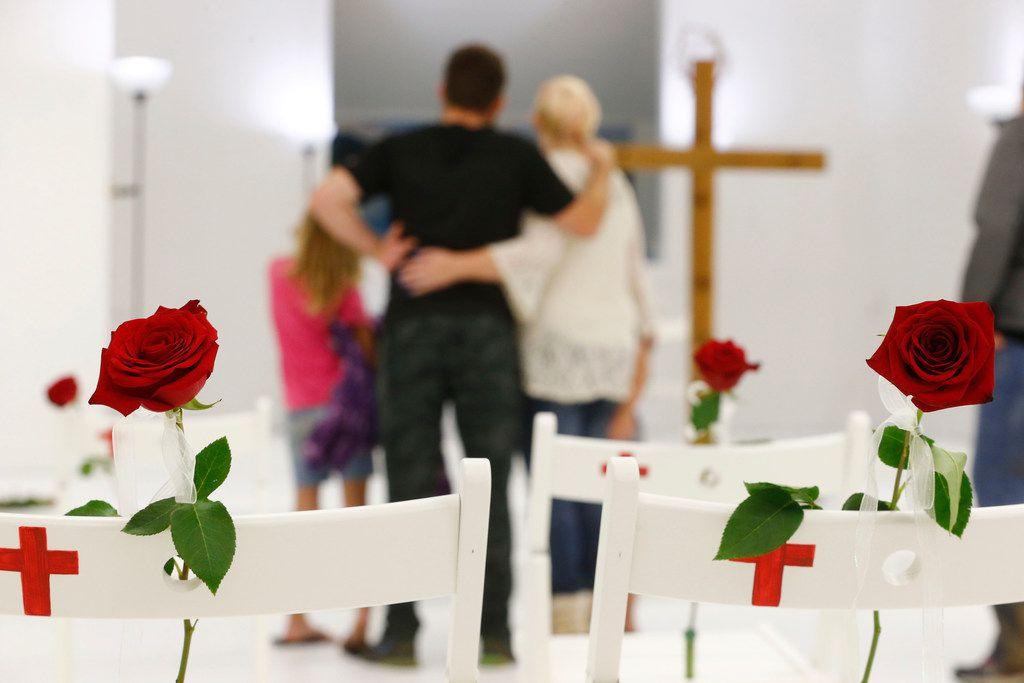 Roses are left on the chairs representing the victims as visitors are allowed into First Baptist Church to pay their respects a week after the shooting in Sutherland Springs, Texas on Nov. 12, 2017. The church was the site of a shooting that killed 26 and left 30 injured.