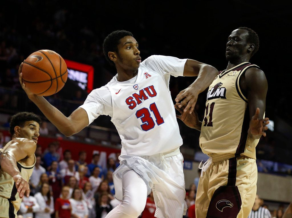 Southern Methodist Mustangs guard Jimmy Whitt (31) passes the ball against Louisiana Monroe Warhawks forward Kiir Deng (11) in the second half at Moody Coliseum in Dallas on Sunday, Nov. 12, 2017. The Southern Methodist Mustangs won 83-65. (Rose Baca/The Dallas Morning News)