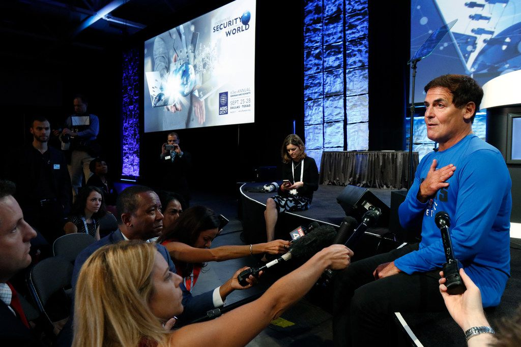 Dallas Mavericks owner Mark Cuban, right, answers question from the media about honoring the national anthem after he was a guest at the 63rd American Society for Industrial Security International Annual Seminar at the Kay Bailey Hutchinson Convention Center on Monday, September 25, 2017 in Dallas. (David Woo/The Dallas Morning News)