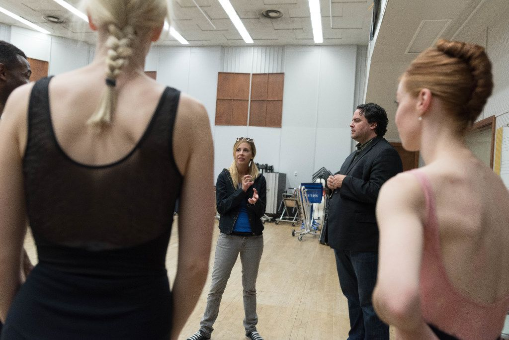Dallas Neo-Classical Ballet artistic director Emilie Skinner (background left) and Syzygy director Lane Harder talk with dancers during a rehearsal at Southern Methodist University.