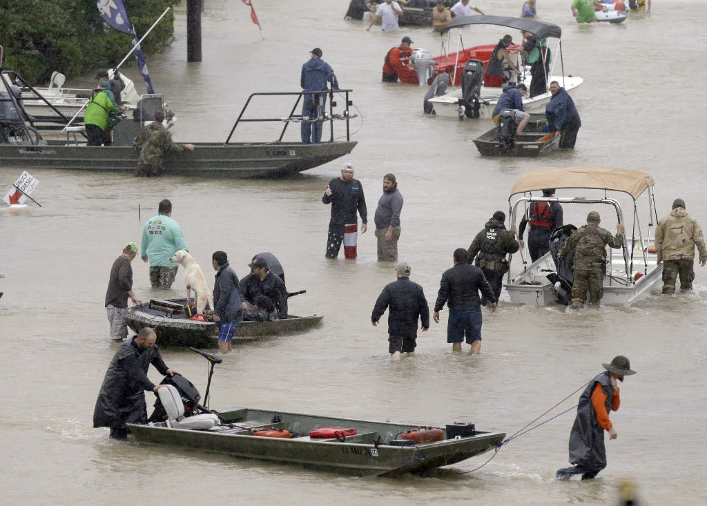 People and rescue boats lined a street in Houston as they helped evacuate residents amid a fourth consecutive day of rain Aug. 28.