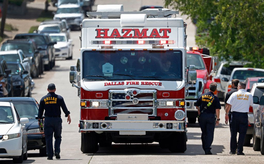 Members of the Dallas Fire-Rescue team leave a shooting scene where police found two people dead at an office building in Lake Highlands near the High Five in Dallas, Monday, April 24, 2017. (Jae S. Lee/The Dallas Morning News)