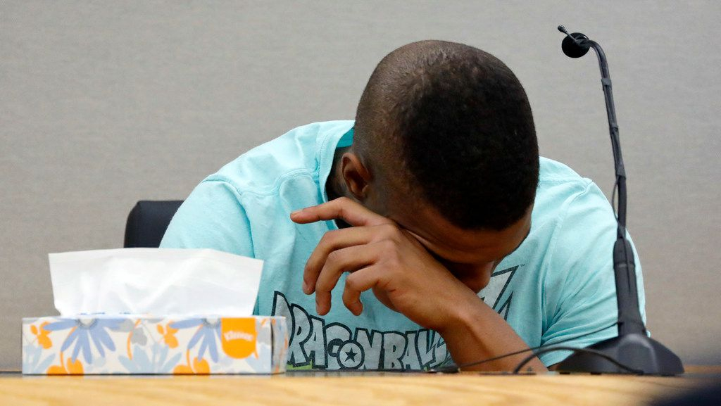 Botham Jean's neighbor Joshua Brown is overcome with emotion after recounting how he'd heard him singing gospel and Drake songs across the hall during Amber Guyger's murder trial. Police confirmed that Brown, 28, died Friday in a shooting. No suspects or motive has been identified.