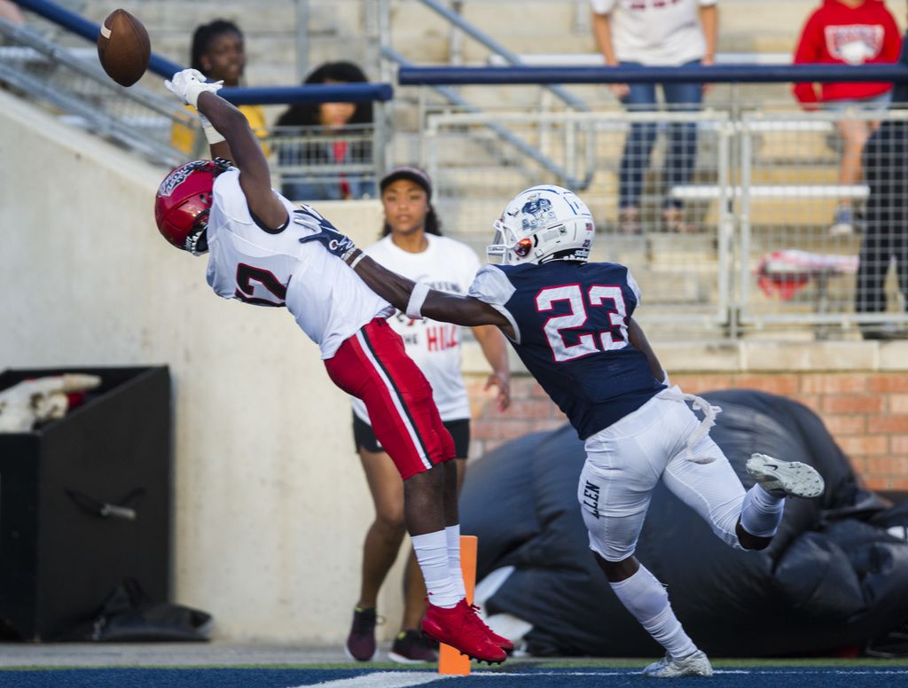 Allen defensive back Zayteak McGhee (23) breaks up a pass to Cedar Hill wide receiver Brian Rainey (12) in the back of the end zone during the first quarter of a high school football game between Allen and Cedar Hill on Friday, August 30, 2019 at Eagle Stadium in Allen. (Ashley Landis/The Dallas Morning News)