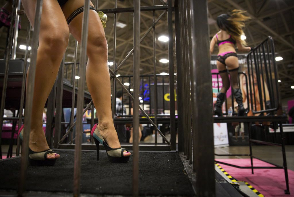 Semi-dressed dancers greeted attendees entering the Exxxotica Expo 2015 on Aug. 7, 2015, at the Kay Bailey Hutchison Convention Center.