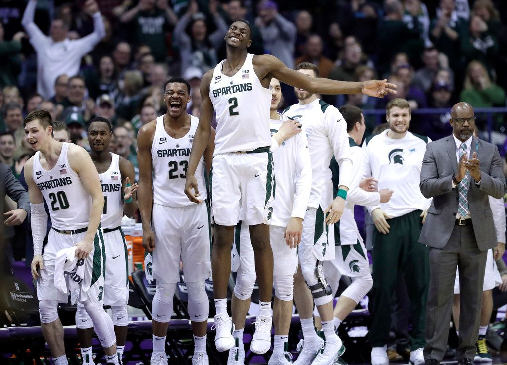 FILE - In this Feb. 17, 2018, file photo, Michigan State forward Jaren Jackson, Jr. (2) smiles as he celebrates with teammates after guard Cassius Winston made a three-point basket during the second half of an NCAA college basketball game against Northwestern, in Rosemont, Ill. Jackson is a possible pick in Thursday's NBA Draft. (AP Photo/Nam Y. Huh, File)
