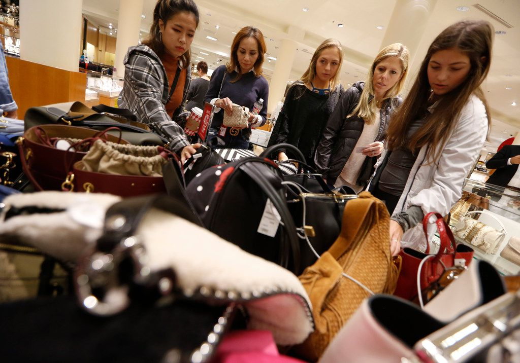 Shoppers peruse purses on sale at Neiman Marcus in NorthPark Center in Dallas on Nov. 23, 2018.