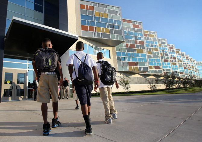 Students arrive for the first day of school at the new Billy Earl Dade Middle School near Fair Park on August 26, 2013. Dallas ISD paid unusually high commissions to a broker during the district's acquisition of land for the school.