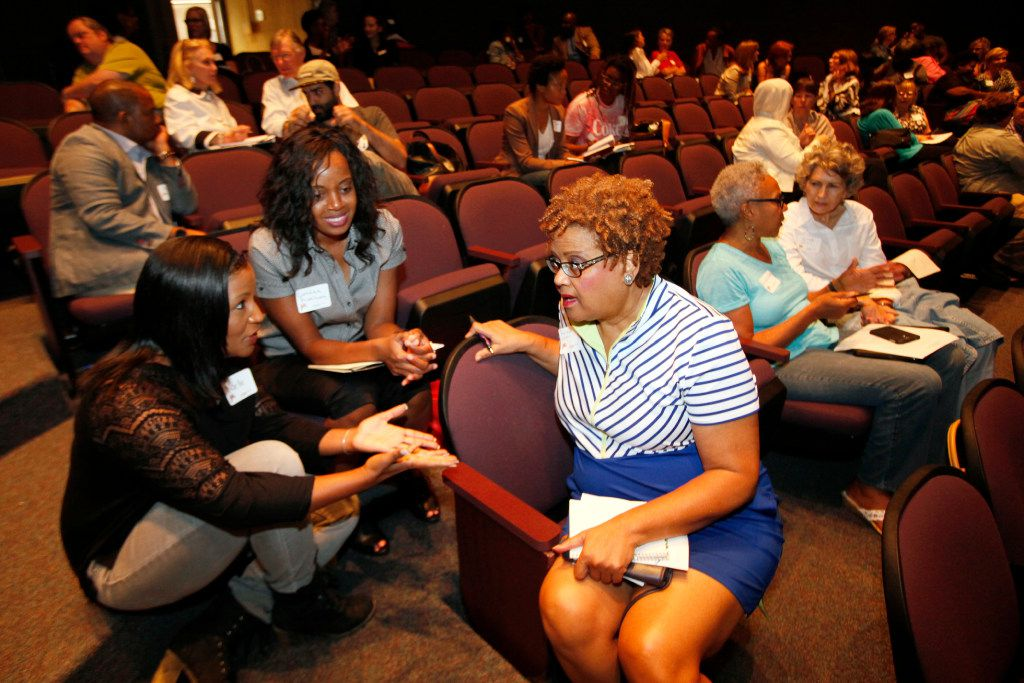 """(from left) Noelle LeVeaux, with the Dallas Convention and Visitors Bureau; Corraina Anthony, with the Dallas Regional Chamber; and Ramona Logan, of Carrollton, discuss a topic about the city of Dallas during the community forum series Actions Speak Louder hosted by The Dallas Festival of Ideas, on Sept. 17, 2016 at El Centro College in downtown Dallas. The women discussed the question, """"if there was a book about the story of Dallas what would your chapter be titled?"""" (Ben Torres/Special Contributor)"""