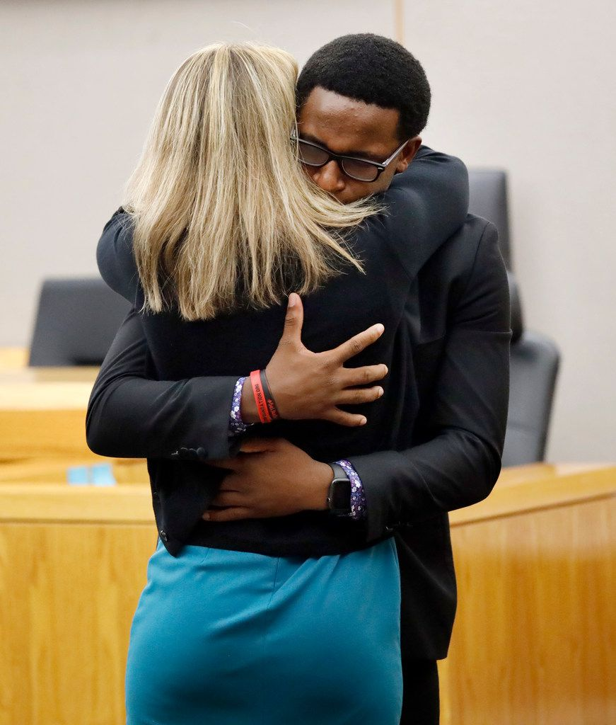 Botham Jean's younger brother Brandt Jean hugs Amber Guyger after a jury sentenced her to 10 years in prison Wednesday.