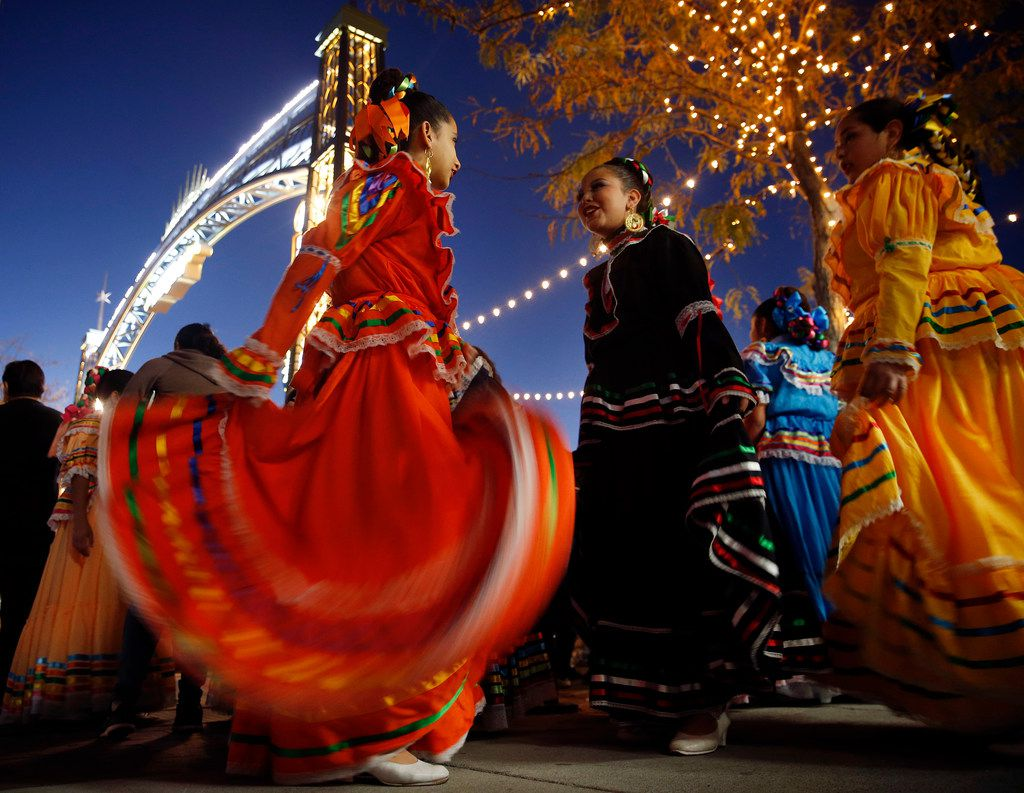 La Fe Folklorico dancers prepare to perform during the Paseo de Las Luces grand opening, Wednesday, November 7, 2018. The project is a $6.4 million investment in El Paso's downtown shopping district. It has long been the gateway to Juarez, Mexico leading to the bridge and its border crossing. They hope to do the same on the other side of the Rio Grande River enhancing the area between the Santa Fe International Bridge and San Jacinto Plaza.
