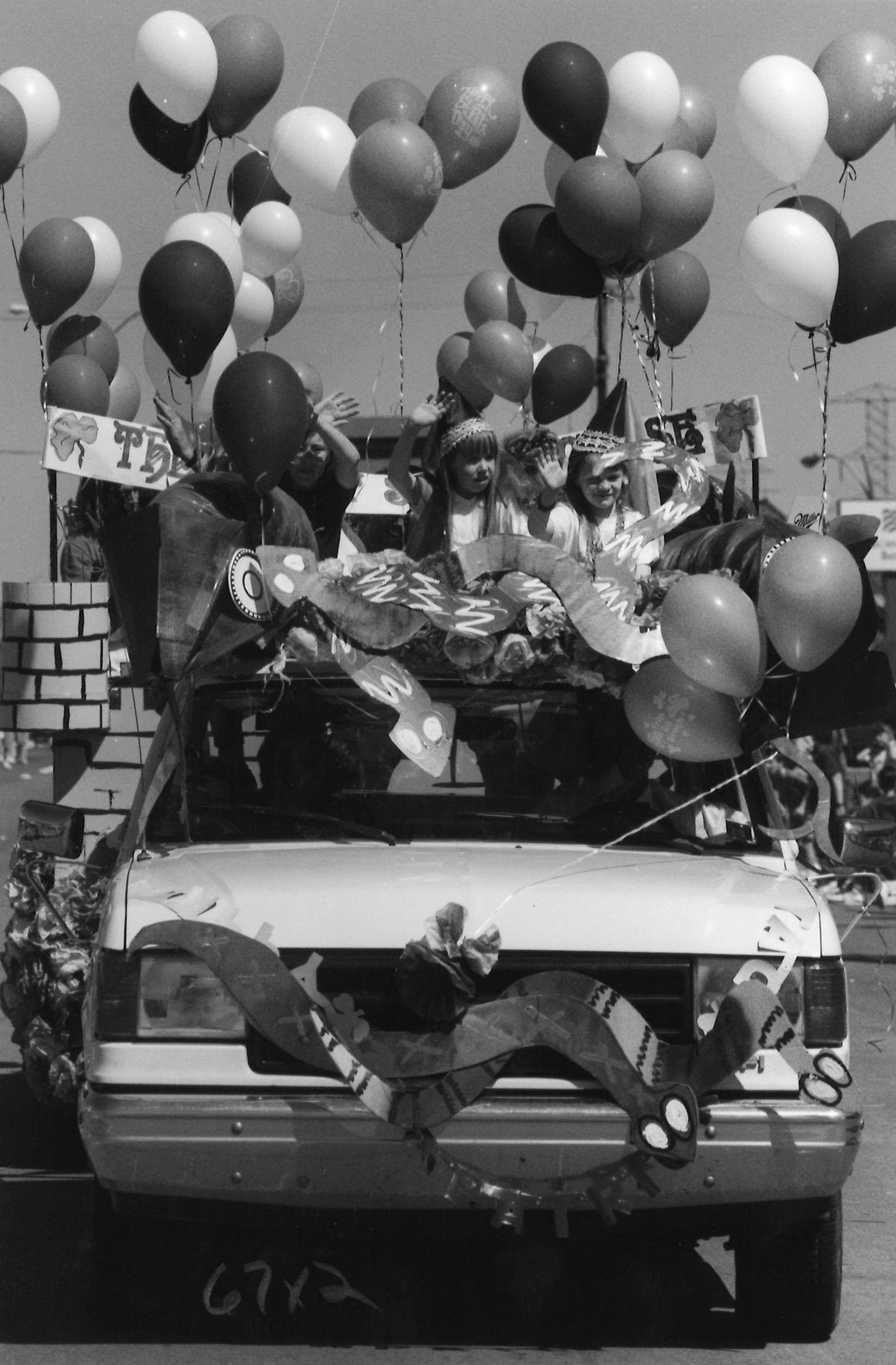 March 17, 1990: Kids wave while riding in the Greenville Avenue parade.