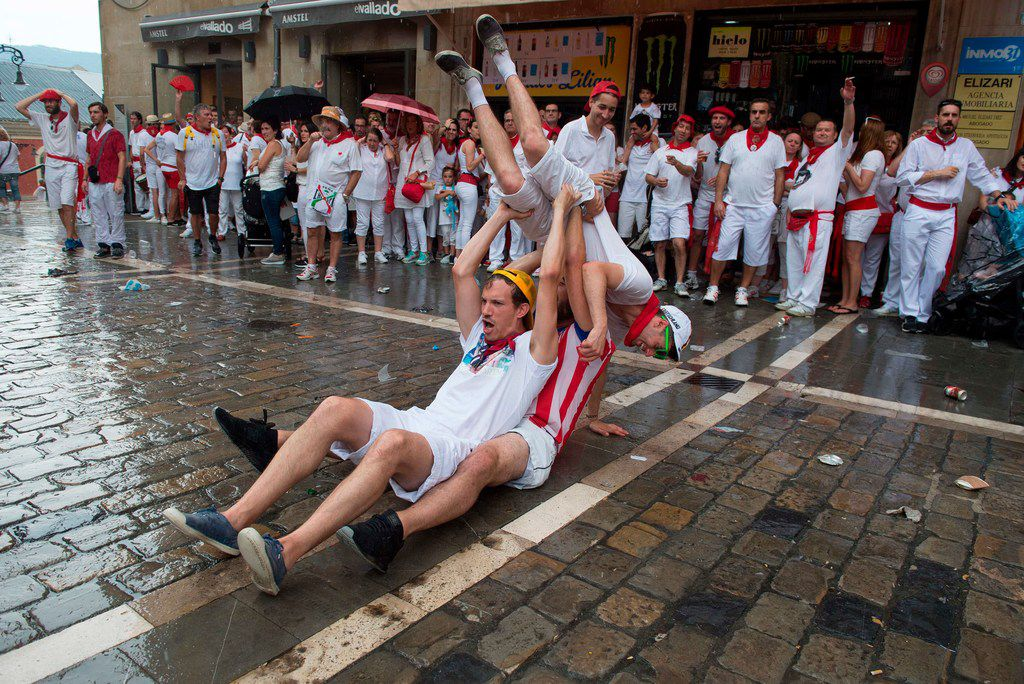 Revellers enjoy festvities on the first day of the San Fermin bull run festival in Pamplona.