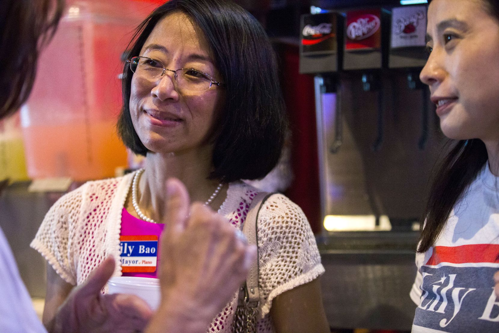 """Plano mayoral candidate Leilei """"Lily"""" Bao talks with supporters at an election night campaign party on Saturday, May 6, 2017 at Texadelphia in Plano."""