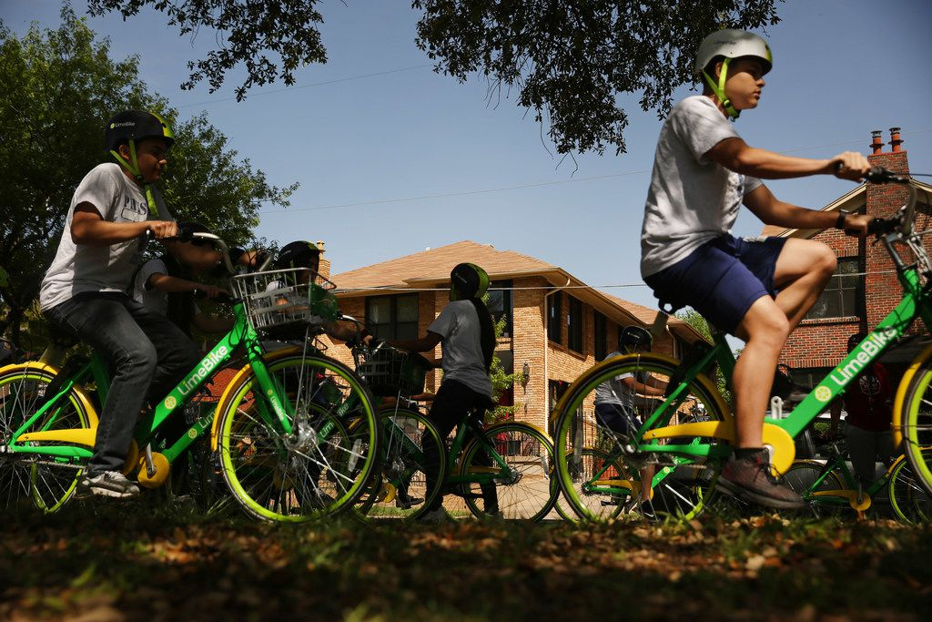 Townview Magnet Center physical education students ride Lime bikes  along Blaylock Drive and Colorado Boulevard in the Lake Cliff Historic District in the Oak Cliff.