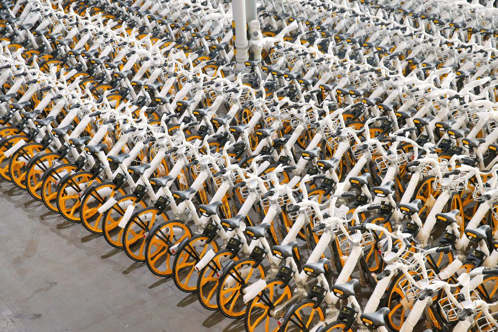 Rows of assembled VBikes, a rent-a-bicycle via downloadable app, are lined up in a Garland warehouse. The stationless bike sharing program features cycles that come unassembled from China. They are put together in the warehouse and those that are in disrepair are brought in from the field to be fixed.