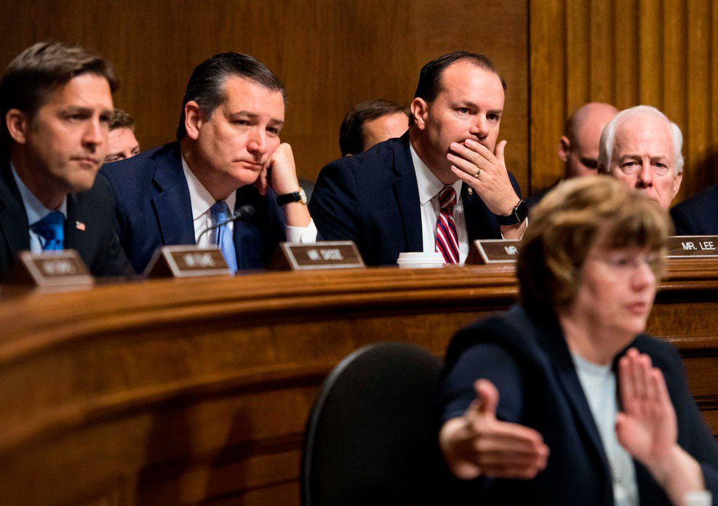 Rachel Mitchell, counsel for Senate Judiciary Committee Republicans, questions Dr. Christine Blasey Ford about allegations of sexual abuse as part of Brett Kavanaugh's Supreme Court confirmation hearing on Sept. 27, 2018. Behind her are GOP senators, from left,  Ben Sasse, Ted Cruz, Mike Lee and John Cornyn.