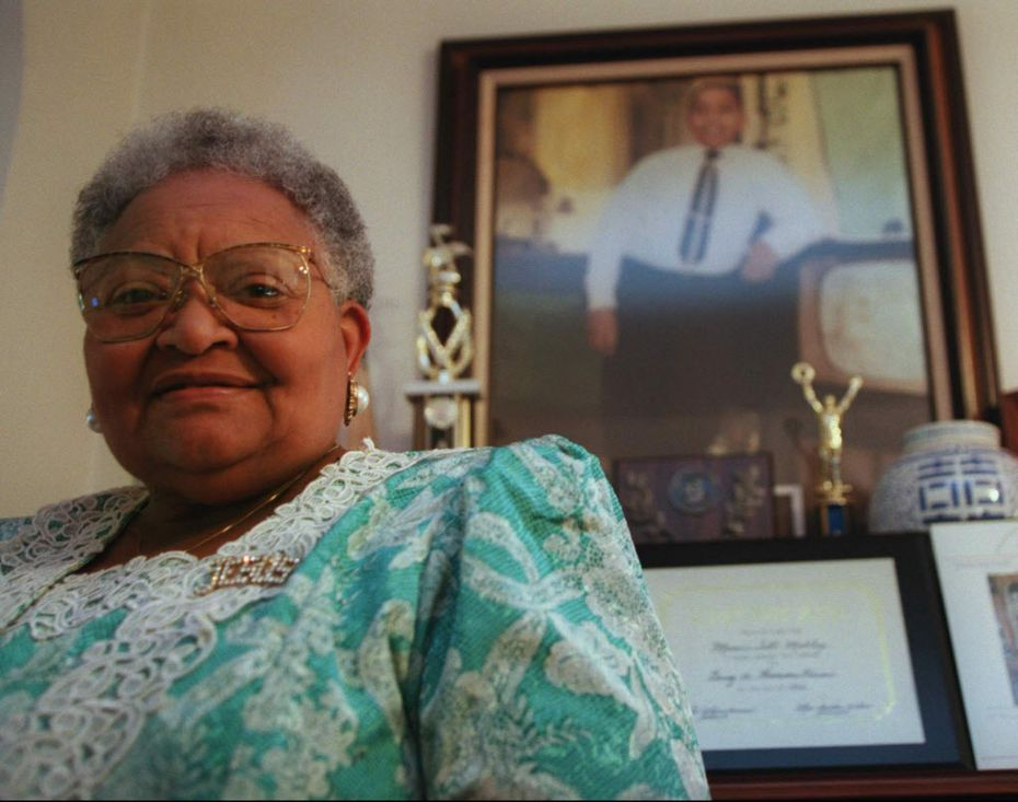 Mamie Till-Mobley stands before a portrait of her slain son, Emmett Till, in her Chicago home on July 28, 1995. (AP Photo/Beth A. Keiser)
