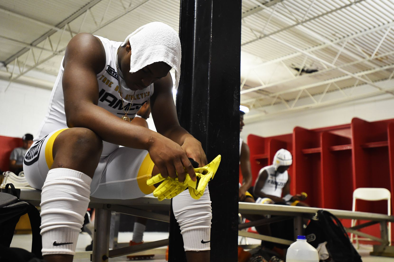 True Buzz' Savion Reed has a moment to himself in the locker room before the Pylon 7v7 National Championship event held at Woodward Academy in Atlanta, Georgia, on May 26, 2019.