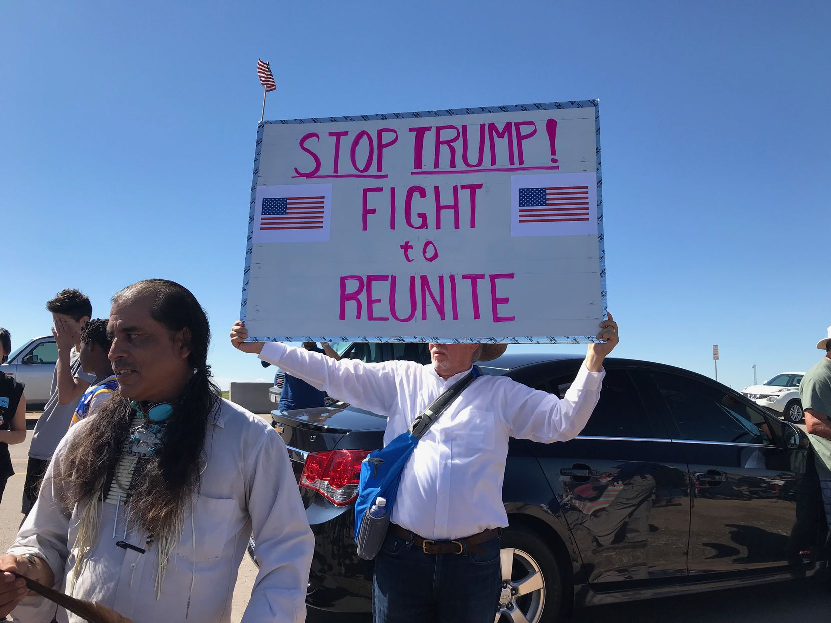 Marchers protest the Trump administration's policy of separating children from their parents as families arrive at the nation's southern border. (Alfredo Corchado/Dallas Morning News)