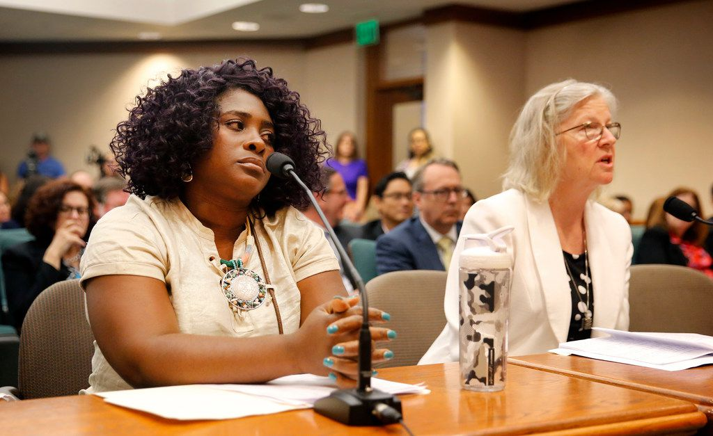 Linda Badawo (left) of Mesquite, Texas listens to CPS director of services Elizabeth Kromrei testify before members of the Texas House Committee on Human Services.